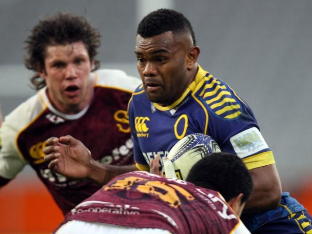 Otago No 8 Naulia Dawai carries the ball as Southland hooker Dillan Halaholo prepares to make a...