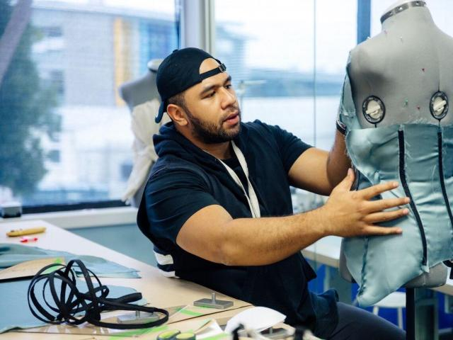 Queenstown fashion designer Peni Moala works on a garment during a Project Runway NZ challenge....