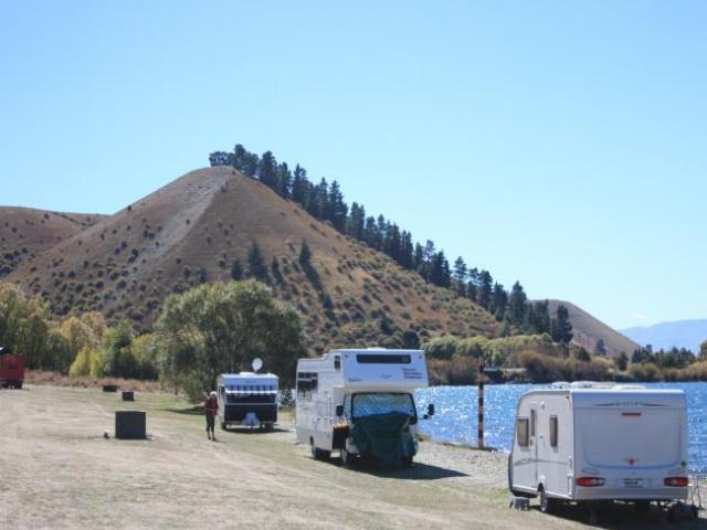 Camping vehicles parked on the shore of Lake Dunstan at Lowburn. Photo: ODT files