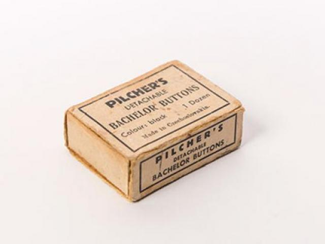 Box of Pilcher's detachable bachelor buttons. Gift of Helen Bissland; Otago Museum Collection....
