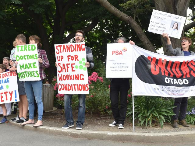 Members of the Resident Doctors Association union and supporters picket near Dunedin Hospital...