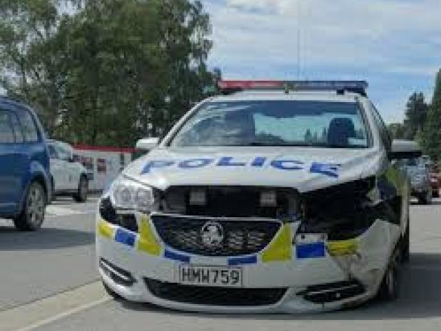 A police car was rendered inoperable after being rammed during the incident. Photo: Sean Nugent
