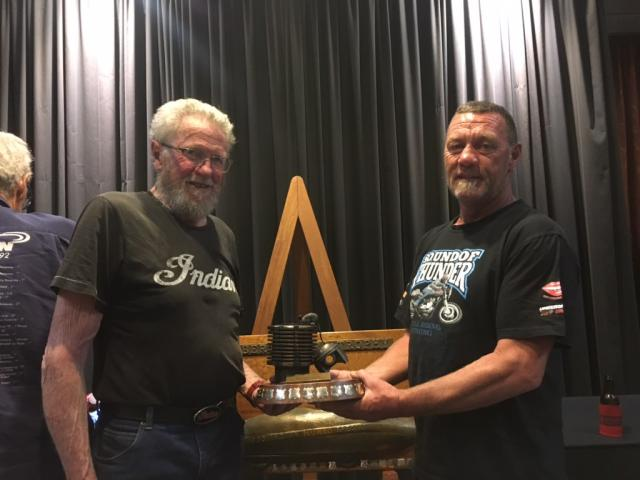 John Munro (left) presents the prestigious Spirit of Burt Munro award to Alexandra motorbike...