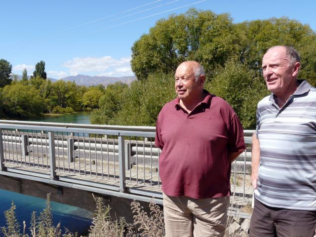 Inspecting the aging Albert Town bridge is (left) Albert Town resident Bruce Hebbard and Albert...