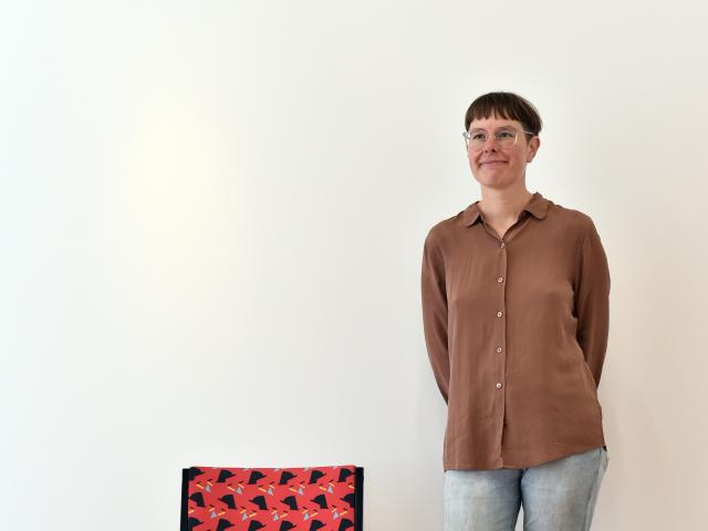 2018 Frances Hodgkins Fellow Louise Menzies with one of the office chairs she has re-covered in a...