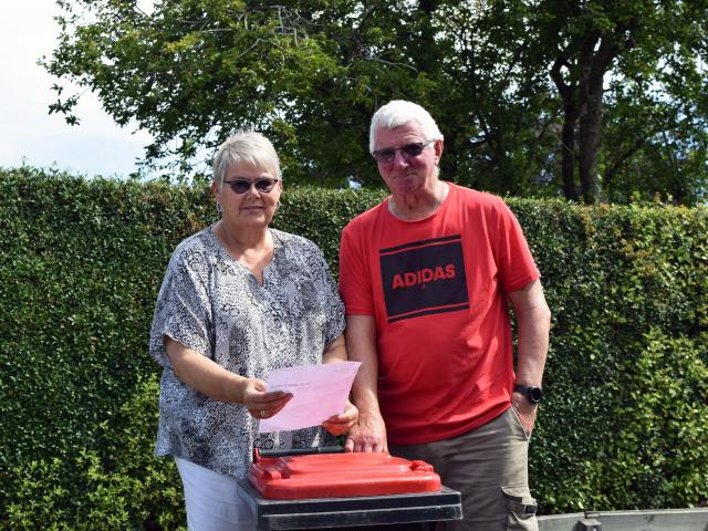 Retired couple Karen and Dennis Lobb inspect their annual bill for the collection of an 80-litre...