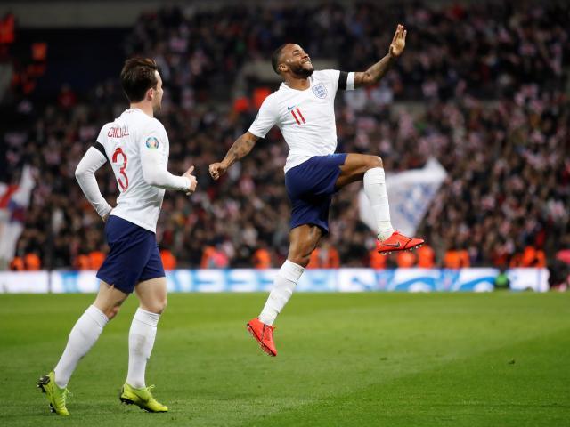 England forward Raheem Sterling celebrates scoring his third goal during a demolition job against...