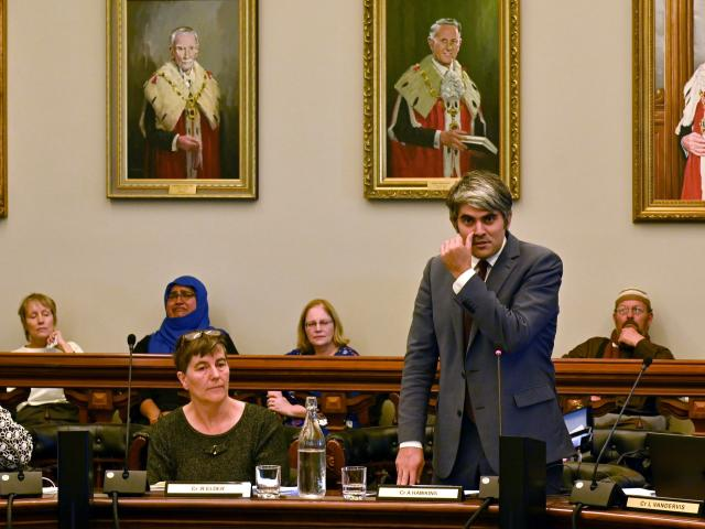 An emotional Dunedin city councillor Aaron Hawkins (right) urges the community to tackle racism...