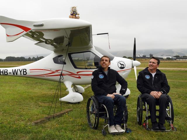 Handiflight pilots Alex Krol (left) and Eric Dabas in front of the German-built CTLS light sport...