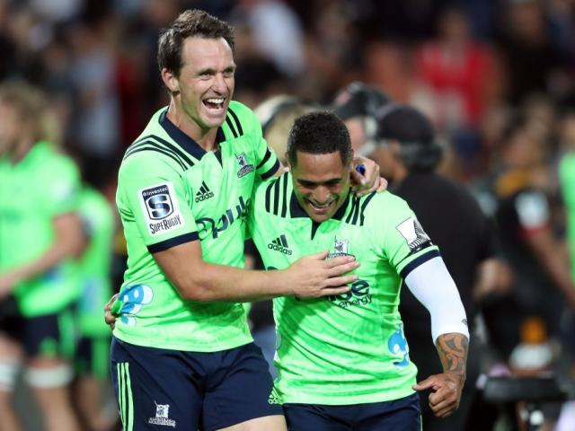Highlanders co-captain Ben Smith celebrates with Aaron Smith. Photo: Getty Images