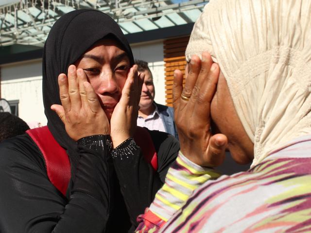 Shamshad Akhtar and Hafswa Hameed cry during the vigil in Wachner Pl in Invercargill yesterday,...