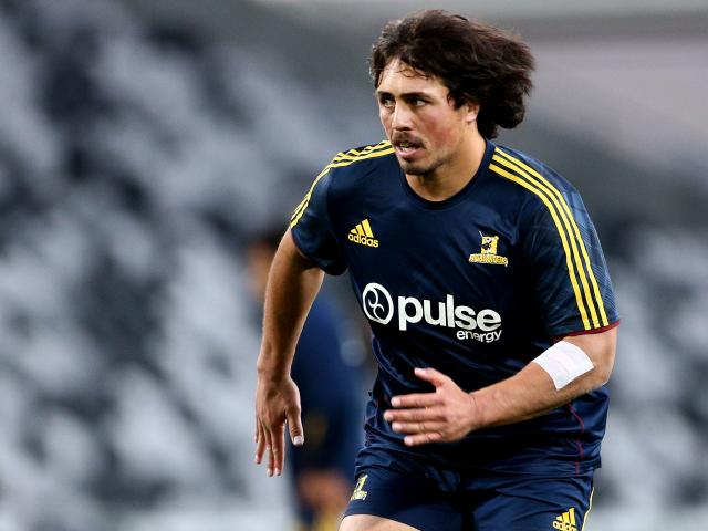 Highlanders looshead prop Daniel Lienert-Brown warms up for the match against the Hurricanes at...