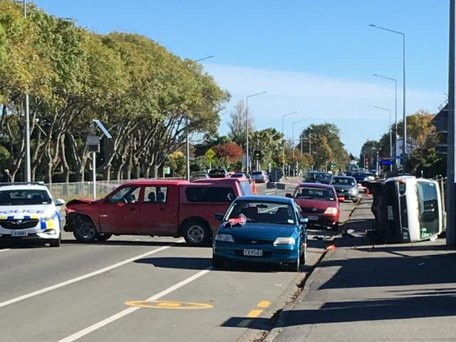 A van lies on its side after a police pursuit ended in a crash in Invercargill today. Photo:...