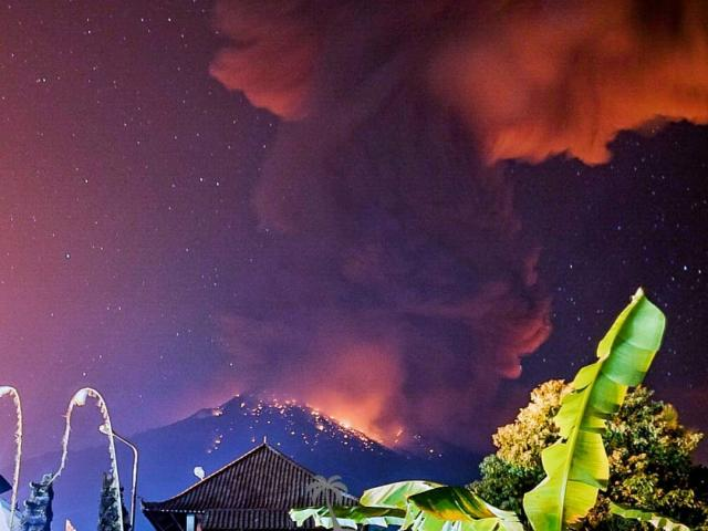 Thick smoke and glow from lava are seen as Mount Agung volcano erupts in Karangasem Regency, Bali...