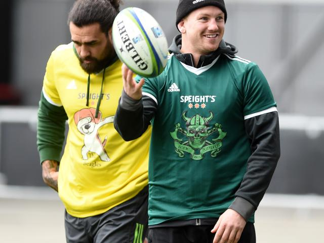 Highlanders flanker James Lentjes at training yesterday at Forsyth Barr Stadium. In behind is...