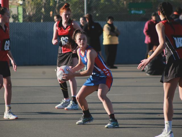 St Kevin's College A wing defence Megan Dodd looks for support during her team's 35-24 win over...