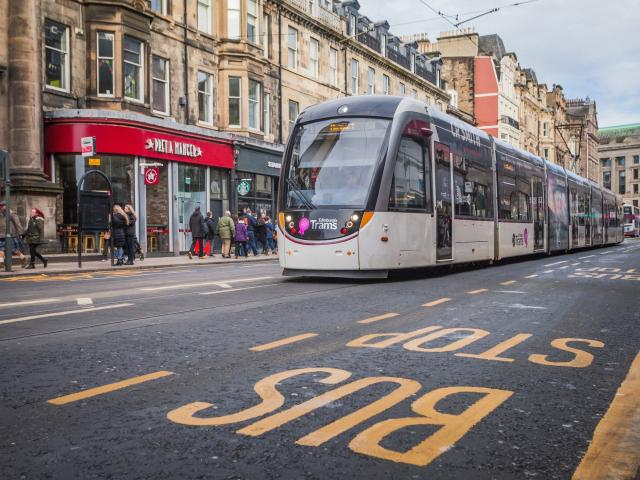 An electric tram glides through central Edinburgh. Photo: Getty Images