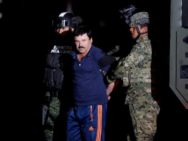 """Joaquin """"El Chapo"""" Guzman is escorted by soldiers in Mexico City in January 2016. Photo: Reuters"""