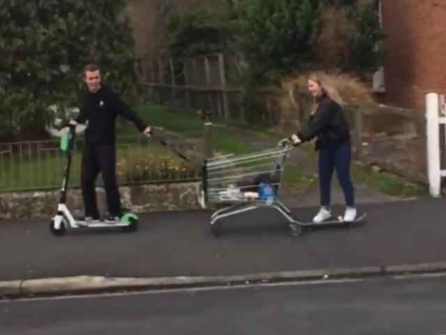 The young man rode a Lime scooter and towed a supermarket trolley behind him while a young woman on a skateboard held on to the back of the trolley. Screengrab: Gerard O'Brien