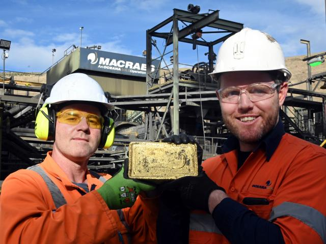 Gold Room services co-ordinator Rhys Davies (left) and Macraes general manager Matt Hine hold a...