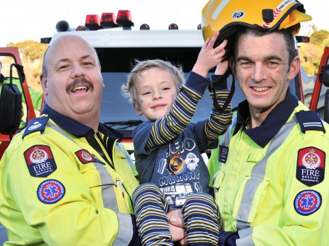 Reunited with the Port Chalmers good volunteer firefighters who came to his aid after he fell...