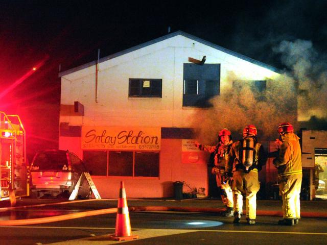Smoke billows from the Satay Station restaurant in Kaikorai Valley Rd in Dunedin last night as...