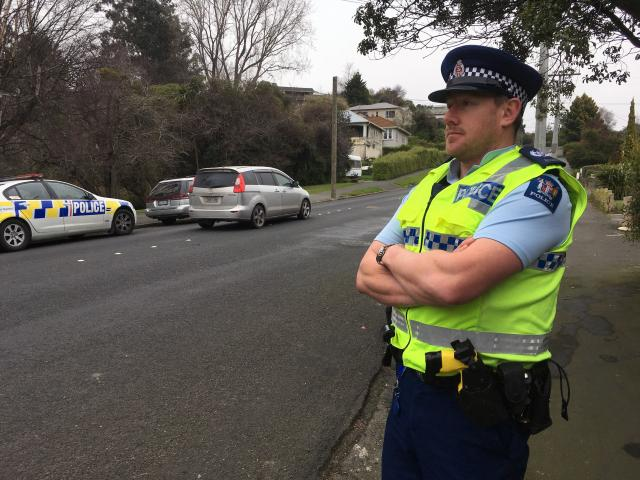 Senior Sergeant Jared Kirk watches motorists in Corstorphine Rd where a mobile speed-camera site...
