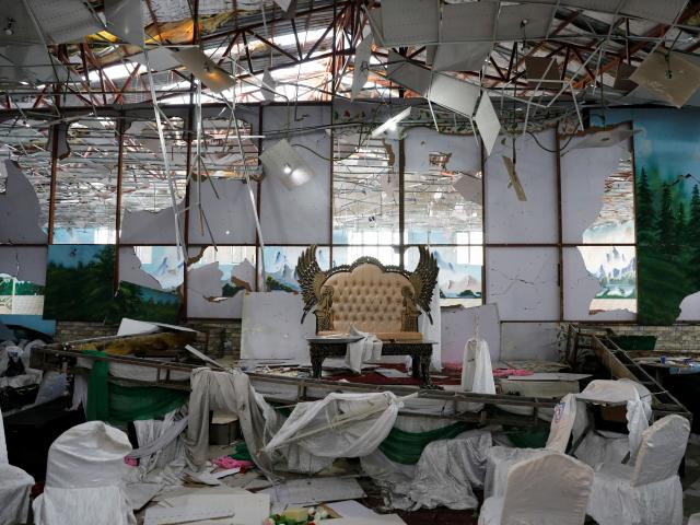 A damaged stage of a wedding hall is seen after a blast in Kabul, Afghanistan. Photo: Reuters