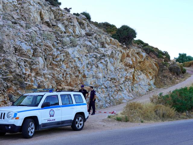 Police officers block the road towards the area where the body of missing 35-year-old British...