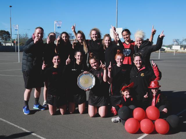 Waitaki Girls' High School Wildfire celebrates winning the North Otago premier netball title by...