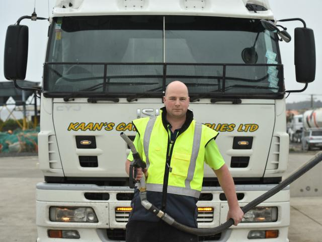 Kaan's Catering Supplies driver Mike Sanders fills up at a local  fuel station in Dunedin after a...