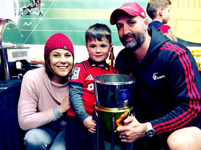 Maree, Parker and Peter Bowden with the Super Rugby trophy. Photo: Supplied