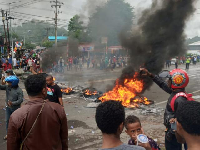 People burn tires during a protest at a road in Manokwari, West Papua, Indonesia. Photo: Reuters
