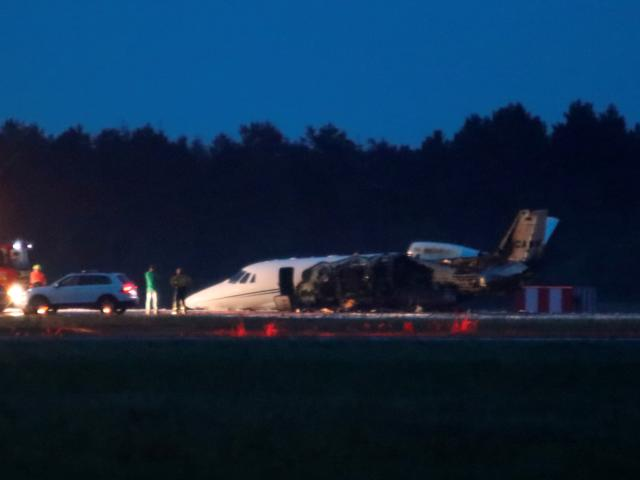 A private Cessna 560XL aircraft is seen after crashing while landing at Aarhus Airport in...