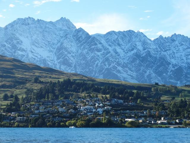 Remarkables soar above the Queenstown suburb of Kelvin Heights and Lake Wakatipu's Frankton Arm....