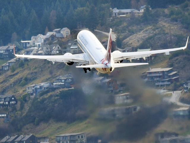 A Virgin Australia aircraft flies over Frankton as it leaves Queenstown  Airport. PHOTO: STEPHEN...