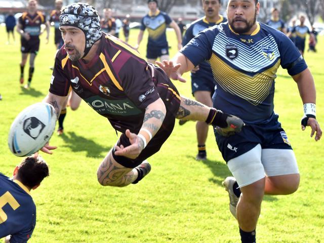 Southland Ram Korey Pennicott passes the ball under pressure from Otago Whaler Louis Till during...