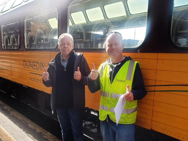 Rail and maritime union delegate Julian Evans (left) with Paul Jeffery, whose hourly wage has...