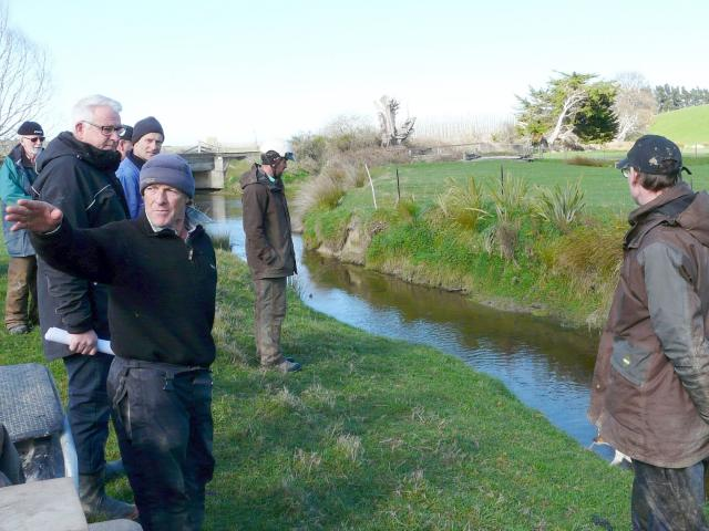 Lovells Flat sheep farmer Bryce Clark shows neighbouring farmers areas of successful on-farm...