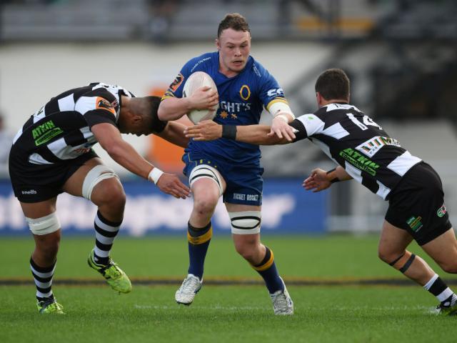 Otago flanker Slade McDowall tries to get between loose forward Marino Mikaele-Tu'u (left) and...