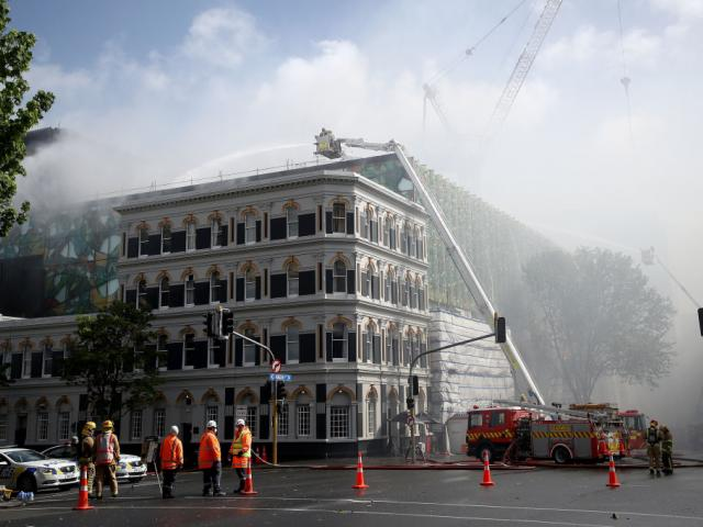 Firefighters are pumping an estimated 200 litres of water per second on the blaze. Photo: Getty