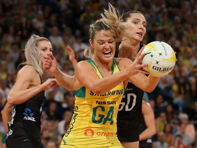 Gretel Tippett of Australia and Karin Burger of New Zealand contest for the ball during the 2019...