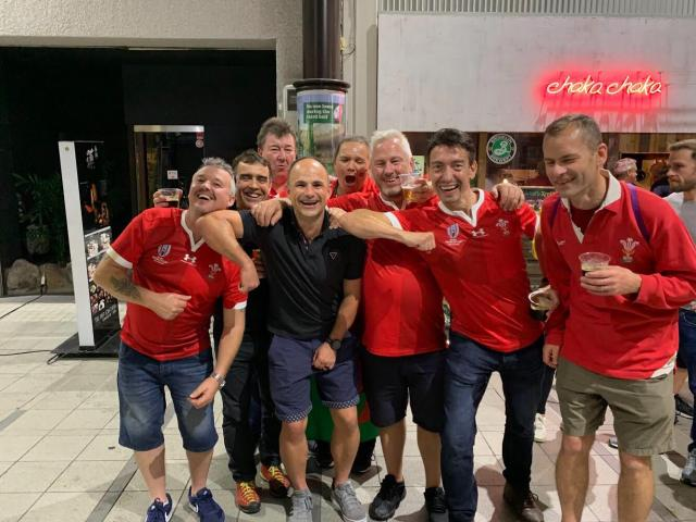 Referee Jaco Peyper poses with Welsh fans following Sunday's Rugby World Cup quarterfinal between...