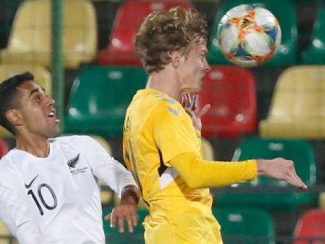 All Whites Sarpreet Singh is beaten in the air by Lithuania's Justas Lasickas during the...