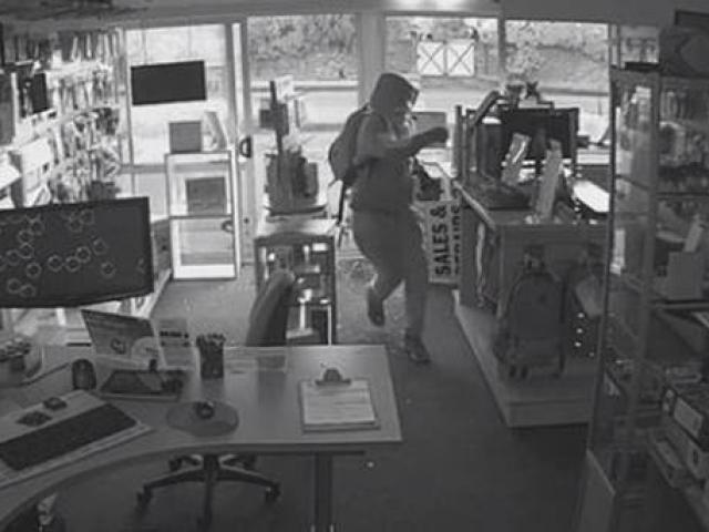 The man enters the store and takes off with two computers. Photo: CCTV