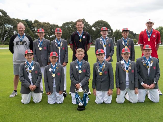 Medbury School's cricket team celebrate their national title at Lincoln. Photo: Ken Baker...