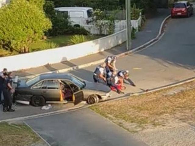 A man is held down by police in Christchurch after the incident. Photo: Video screengrab