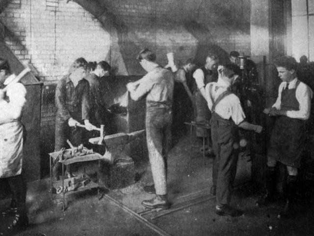The blacksmith class for boys at King Edward Technical College. - Otago Witness, 11.11.1919.