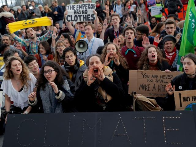 Activists protest outside the venue of the UN Climate Change Conference in Madrid. Photo: Reuters