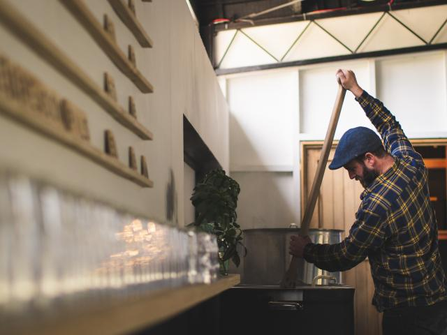 Arc Brewing co-owner Jono Walker during the brewing process. Photo: Hayden Parsons